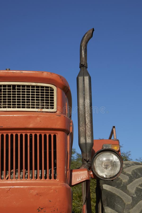 Old tractor watching you on the street of the village royalty free stock photography