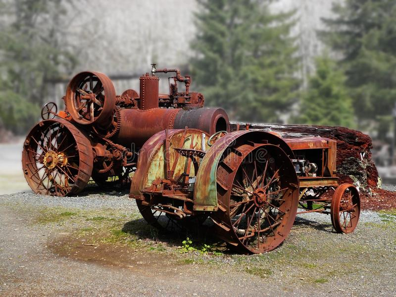 Old tractors. Two old farm tractors one of which is steam powered royalty free stock photography