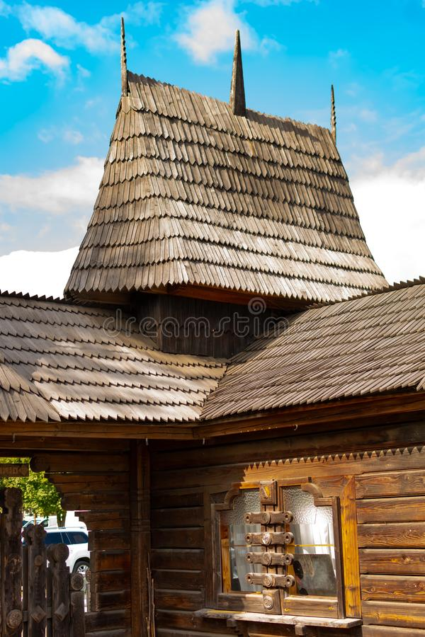 Old traditional architecture with typical wooden huts and mills in Chernivtsi, Ukraine.  stock image