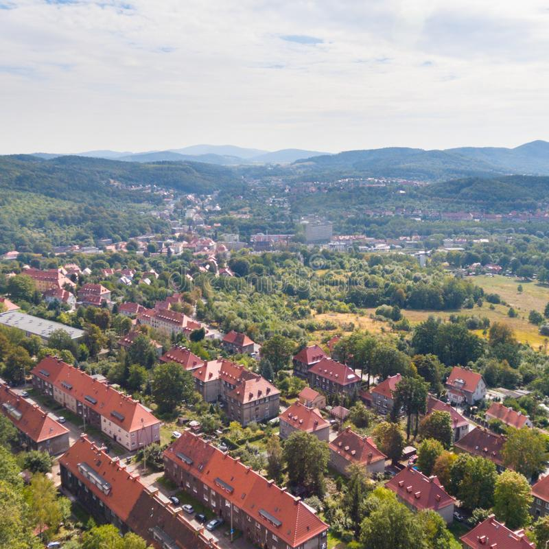 Old European town and green hills drone view from above. Old traditional European town and green hills drone view from above stock photo