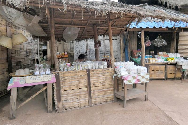 Old traditional grocery shop in the countryside of Thailand with ordinary goods with local hut background. Nan, Thailand December. Photo of Old traditional royalty free stock images