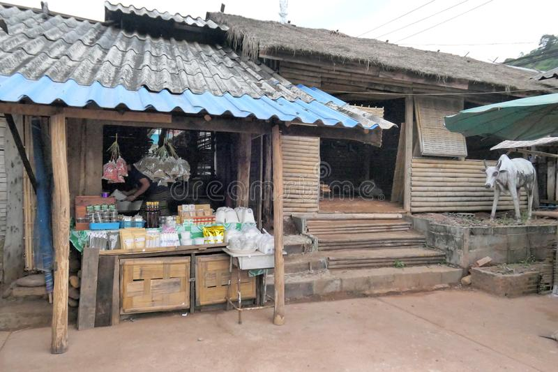 Old traditional grocery shop in the countryside of Thailand with ordinary goods with local hut background. Nan, Thailand December. Photo of Old traditional stock photo
