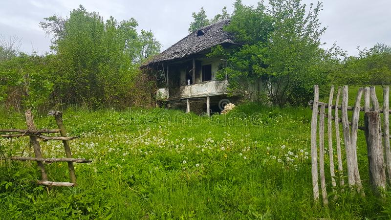 Old traditional house in ruins in romanian countryside stock image