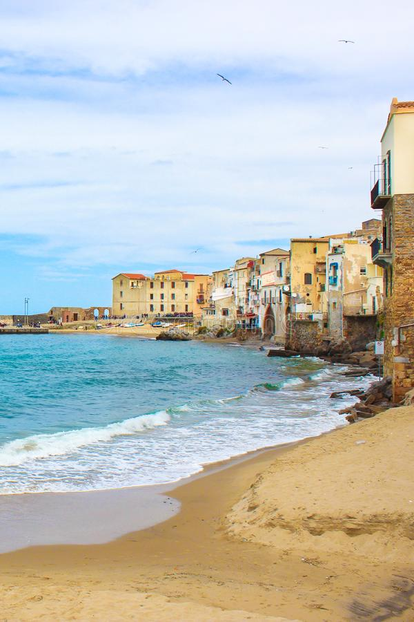 Old traditional houses in the harbour of beautiful Sicilian city Cefalu. The city located on the Tyrrhenian coast. Is on of the major tourist attractions in royalty free stock photos