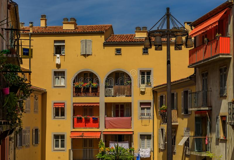 Old traditional houses in the narrow streets in the Old Town Vielle Ville in Nice in the South of France. View of old traditional houses in the narrow streets in stock photos