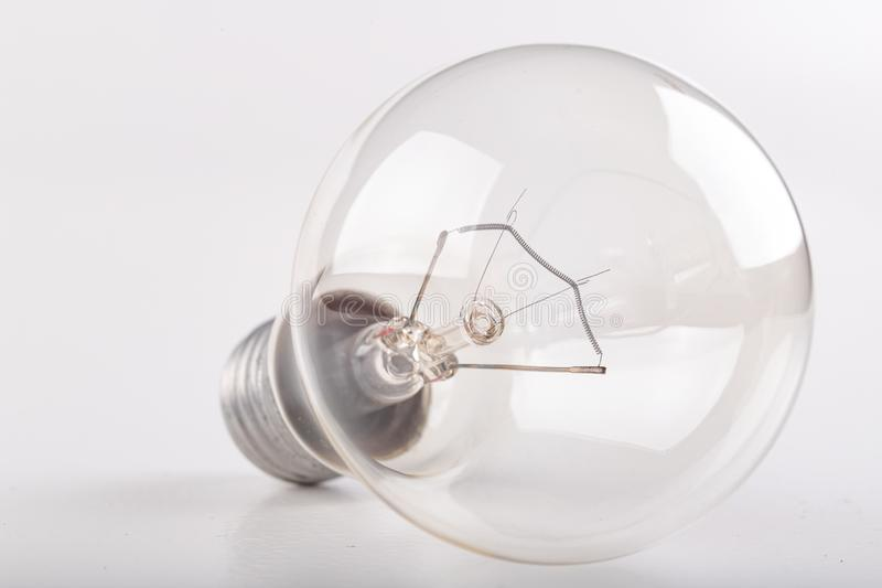 Old traditional light bulb. Household electrical accessories royalty free stock photo