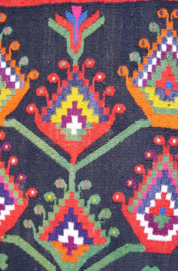 Old traditional ornamental carpet close-up view stock photo