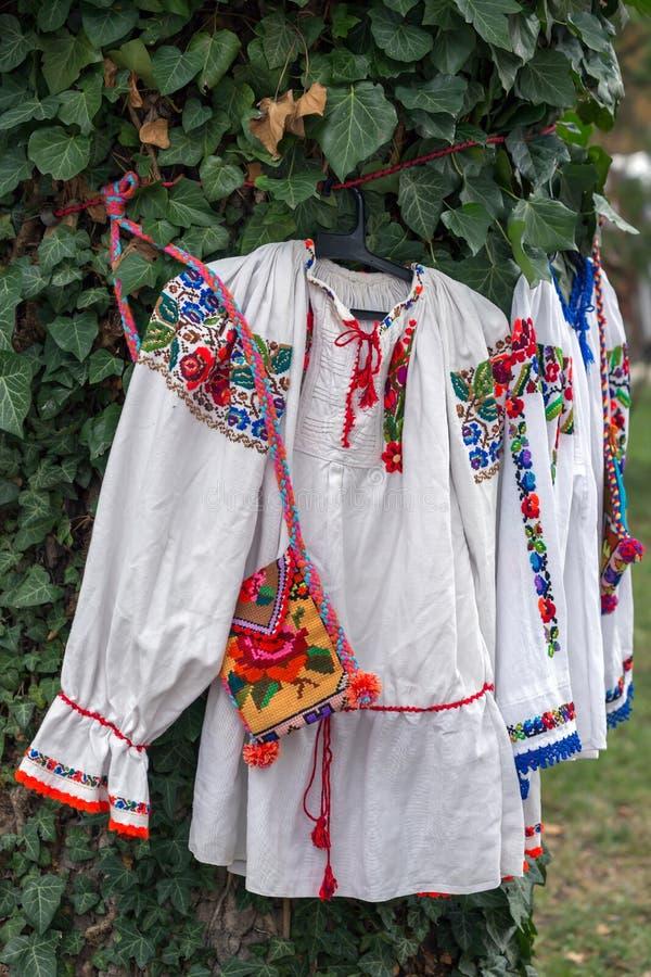Old traditional Romanian folk costumes for Bistrita-Nasaud area. Old traditional Romanian folk costumes with embroidery specific for Bistrita-Nasaud area Romania stock photo