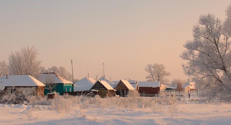 Old traditional russian wood houses in the snow royalty free stock images