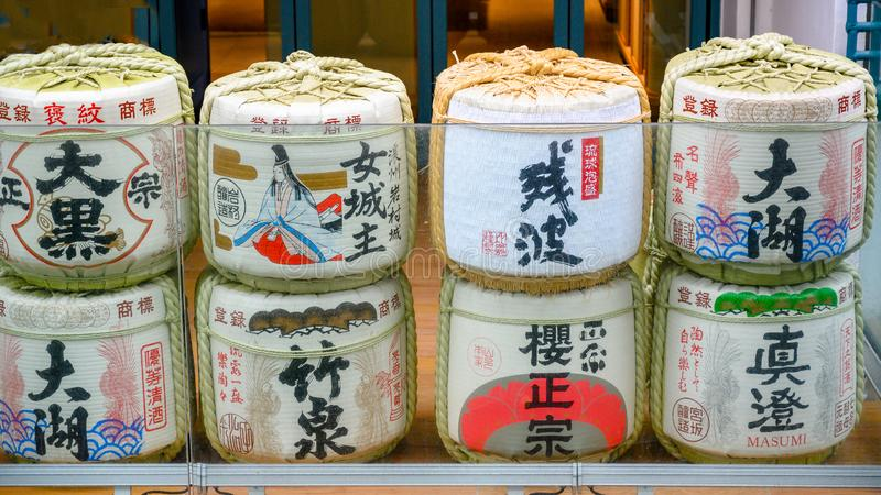 Old traditional sake and rice wine barrels in Hong Kong, China royalty free stock photography