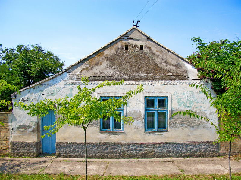 Old traditional village house in Banat, district Vojvodina in Serbia. The old, traditional village house in Banat, district Vojvodina in Serbia royalty free stock photo