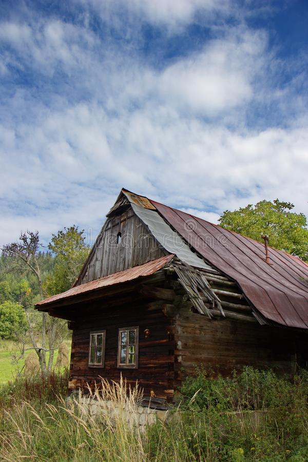 Old traditional wooden house, rural architecture in village of Slovakia royalty free stock image