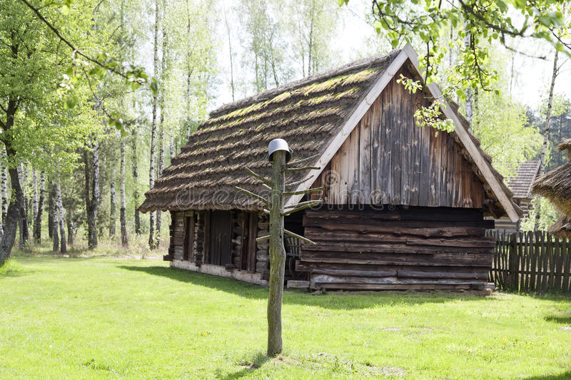 Old traditional wooden polish cottage ,Kolbuszowa, Poland. Old traditional wooden polish cottage in open-air museum, Ethnographic Park, Kolbuszowa, Poland stock image