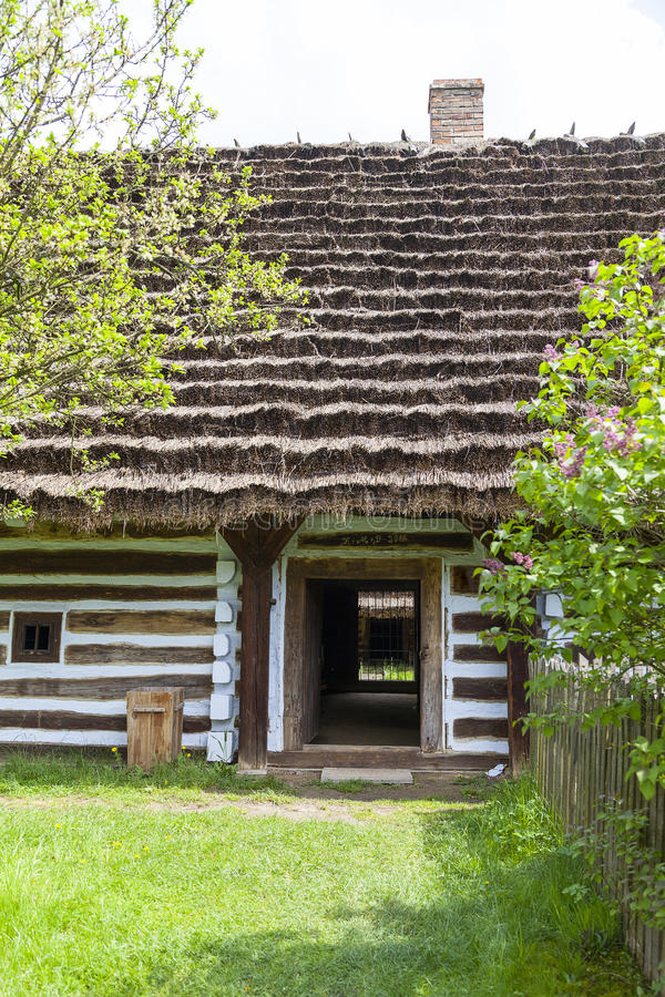 Old traditional wooden polish cottage in open-air museum, Kolbuszowa, Poland. Old traditional wooden polish cottage in open-air museum, Ethnographic Park royalty free stock image