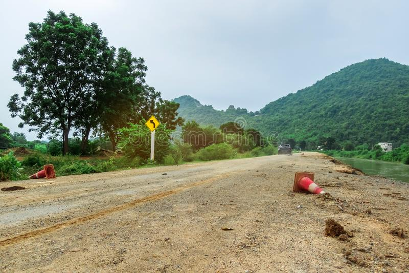 The old traffic cone falling on the road that was being repaired along the irrigation canal. For agriculture stock photos