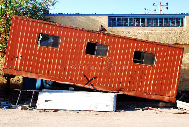 Old Trailer. A red abandoned trailer caravan on the ground stock image