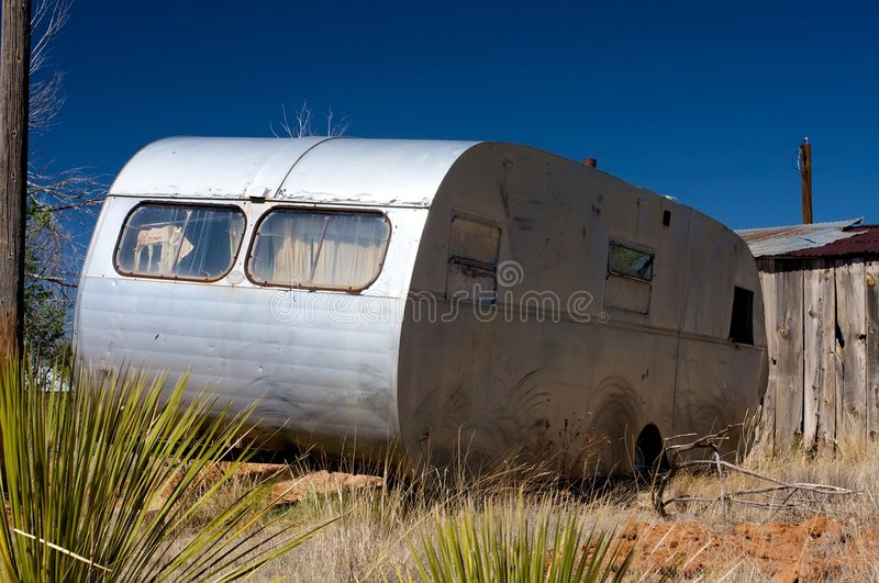 An old trailer and broken down shack. Image of an old trailer and broken down shack royalty free stock image