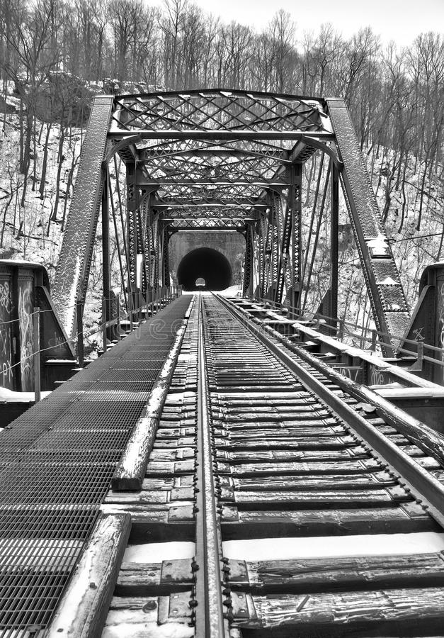 Old train bridge and tunnel in snow royalty free stock photos