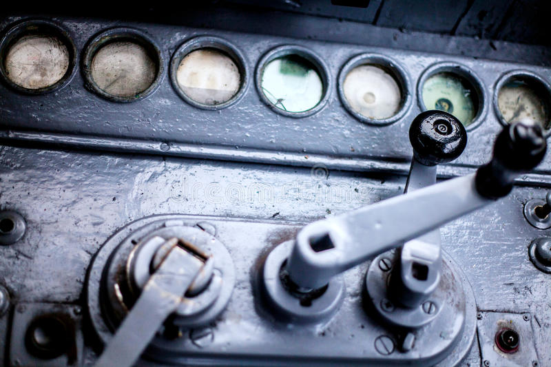 Old train dashboard with clogged goggles and control levers stock images