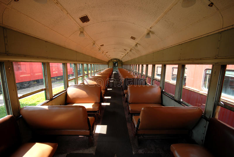 Old train carriage. Empty interior of an old long train carriage royalty free stock images