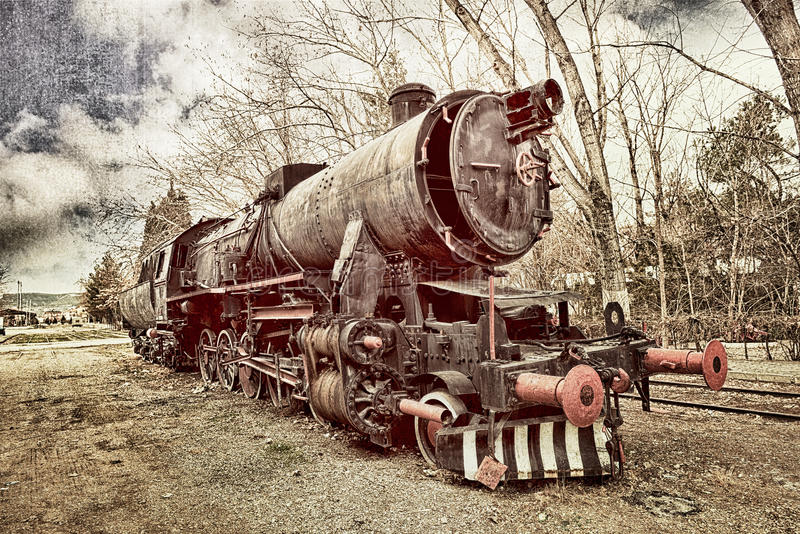 Old train. Old retro steam train locomotive in station stock image