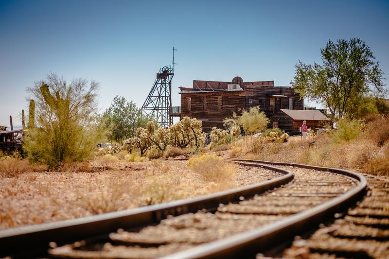 Old Train tracks in Goldfield Gold Mine Ghost Town in Youngsberg, Arizona, USA surrounded by desert royalty free stock photography