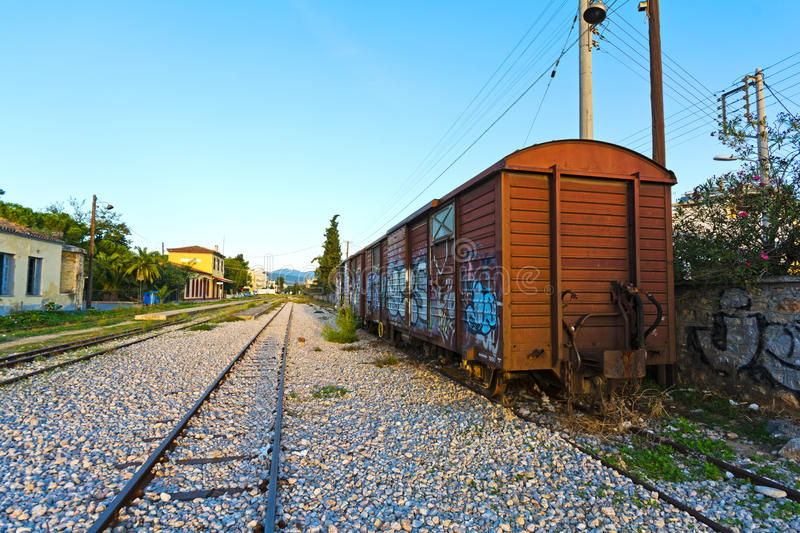Old train wagon. View of an old train wagon, neglected outside an old railway station royalty free stock photo