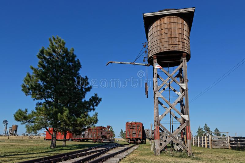Old train and water tower in a western ghost town royalty free stock photos