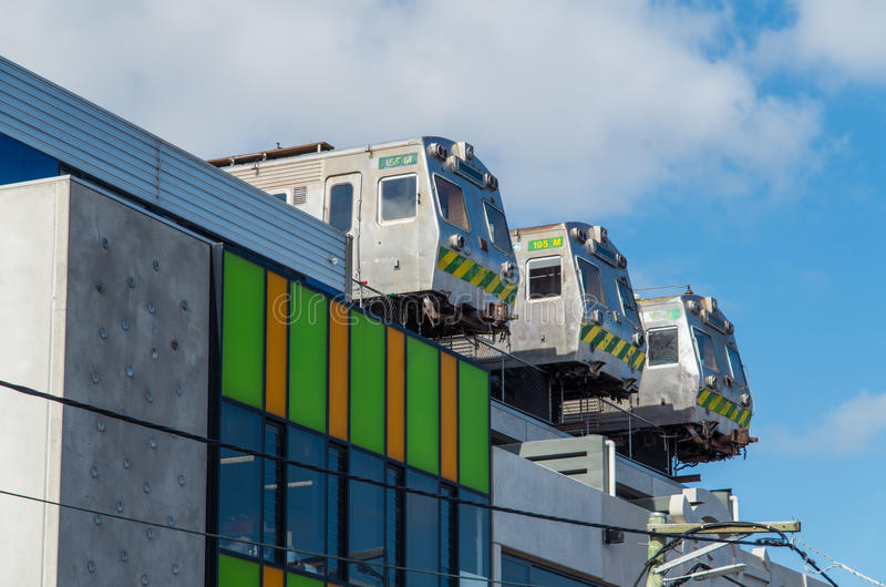 Old trains on the roof of a building in Collingwood, Melbourne, Australia. Old Hitachi suburban commuter trains on the roof of a building in Easey Street in royalty free stock photos