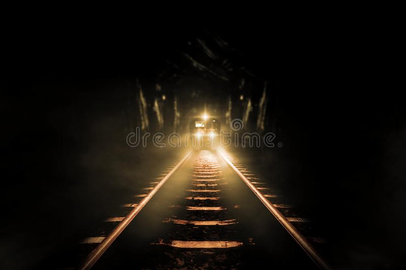 Old trains run through. Old tunnels at night stock photo