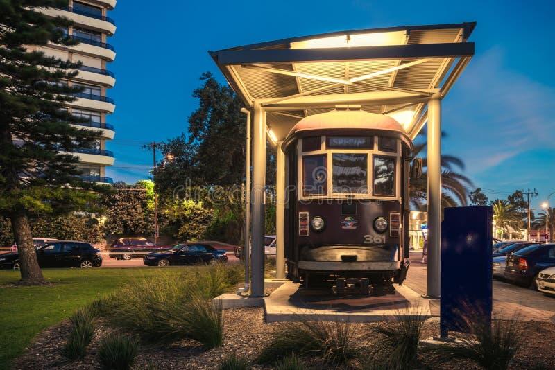 Old tram in Glenelg. Adelaide, Australia - November 8, 2014: Historic red rattler tram in Glenelg on a permanent display at night time stock image