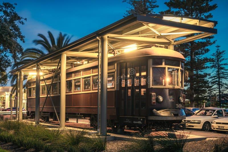 Old tram in Glenelg. Adelaide, Australia - November 8, 2014: Historic red rattler tram in Glenelg on a permanent display at night time stock photo