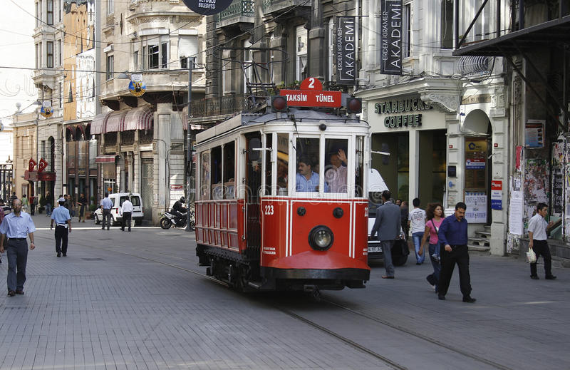 Old tram in Istanbul. ISTANBUL, TURKEY - SEPTEMBER 2: the old tram and people walking in Taksim on September 27, 2007 on Istanbul, Turkey stock image