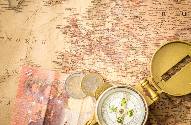 Travel accessories, compass on old, antique Europe map stock photos