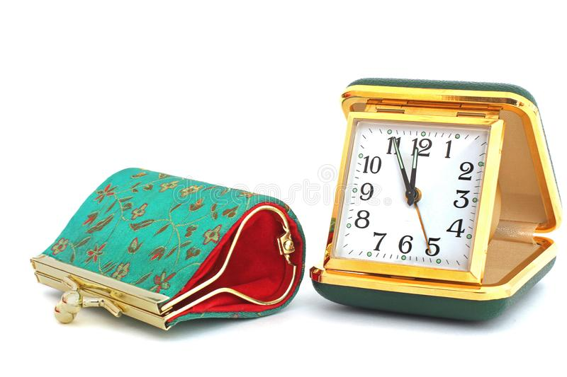 Old traveling clock and women`s wallet. Coin purse. Embroidered patterns. Old traveling clock and women`s wallet. Coin purse stock image