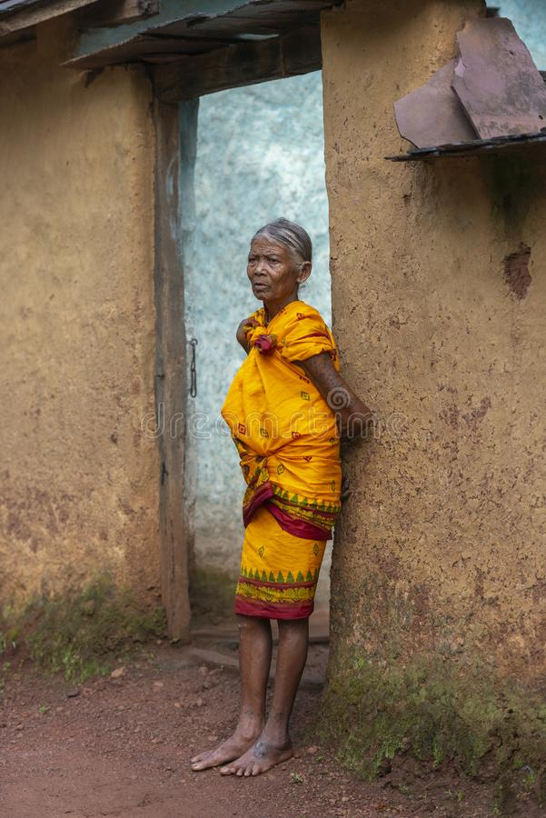 Old Tribal Lady standing outside her house in nangur Village near Jagdalpur,Chhattisgarh,India. Asia royalty free stock photo