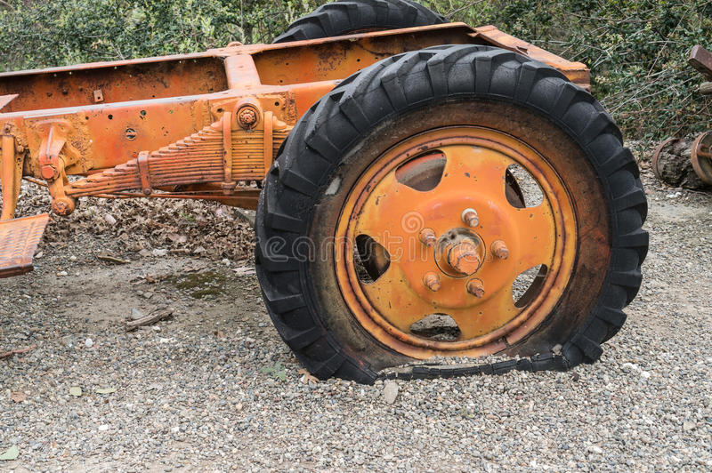 Flat tire on an old truck. Old truck with a flat tire royalty free stock photo