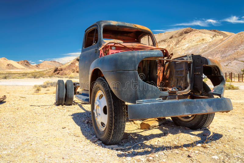 Old truck left in ghost town Rhyolite, in the desert. Old farm truck left in ghost town, in the desert, Rhyolite, Nevada stock photo