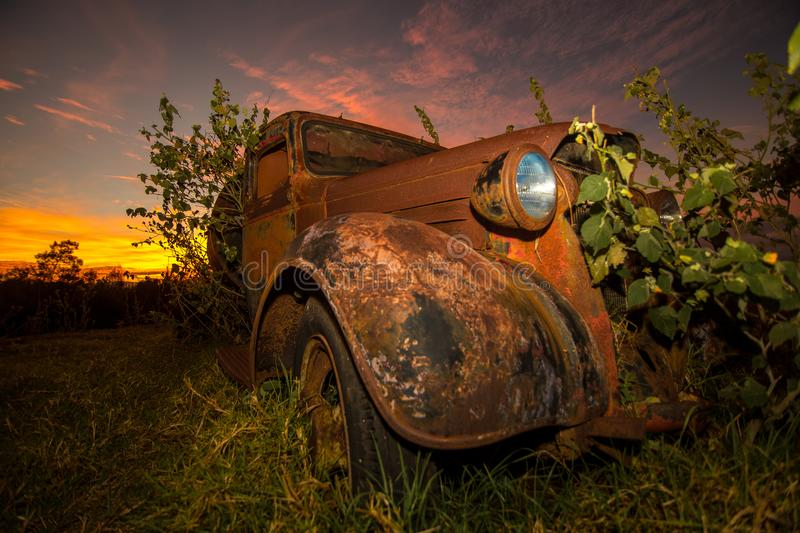 Old truck. An old truck sits during a Maui sunset stock photo