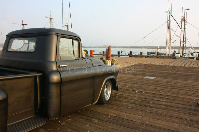 Old Truck on the Pier. An old truck out on a pier stock photo