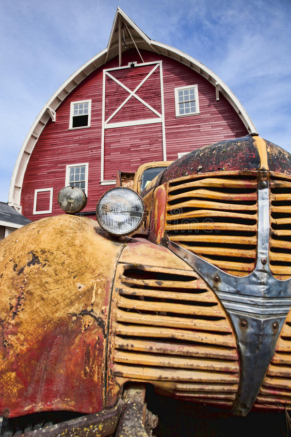 Old truck and red barn. stock photography