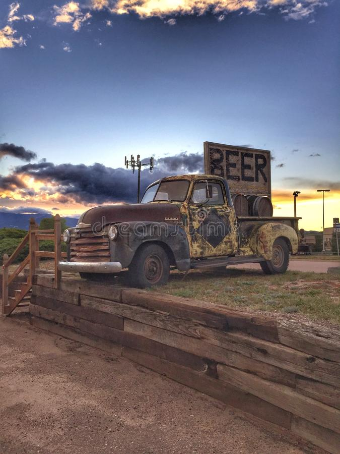 Beer Truck. An old truck sits in front of a brewery royalty free stock photo