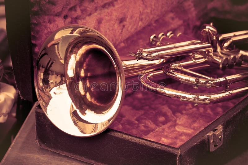 Old trumpet exposed in an italian flea market - toned image.  royalty free stock photo