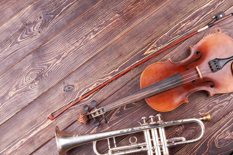 Old trumpet, violin and fiddle stick. stock photos