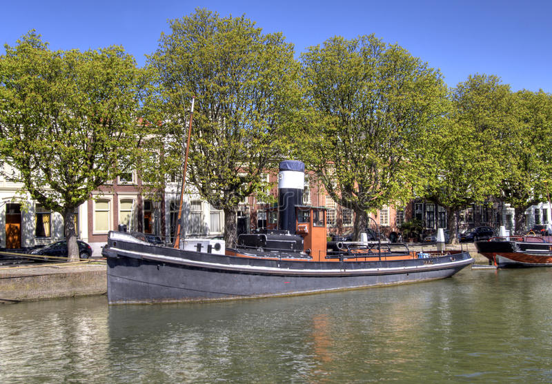 Old Tugboat. In Dordrecht canal, Holland royalty free stock photo