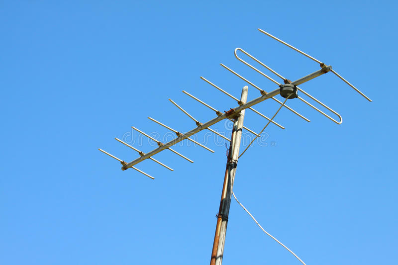 Sky Dish Installation >> Old TV Antenna On House Roof With Blue Sky. Stock Photo - Image: 48902846