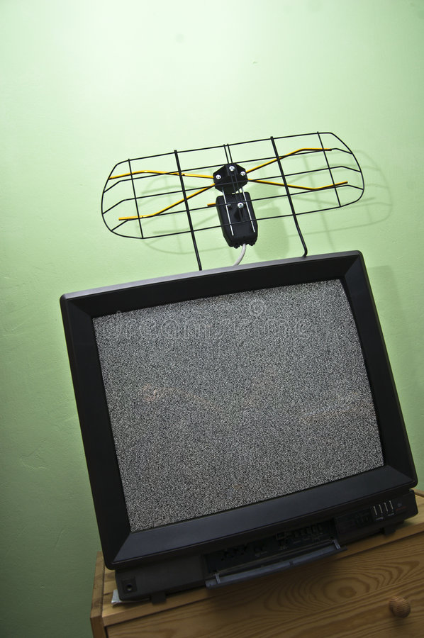Old TV set, noisy picture, aerial. stock images