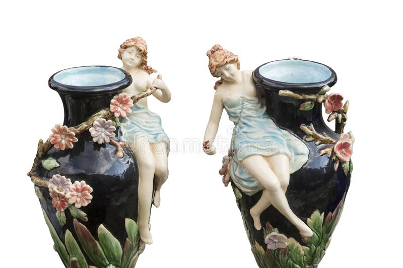 Old twin vase decorated with porcelain figures stock image