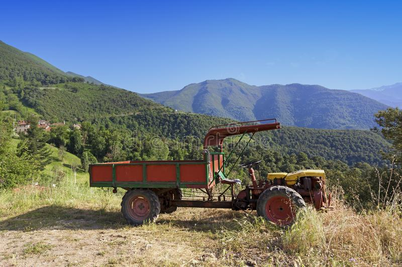Old two wheeled tractor. In the mountains close to a small village stock photo