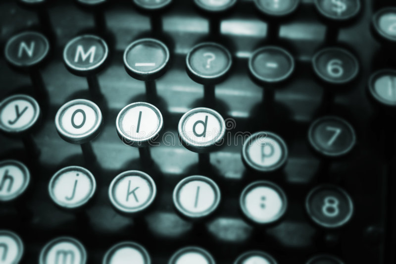 Old typewriter. The word old written on an antique typewriter stock images